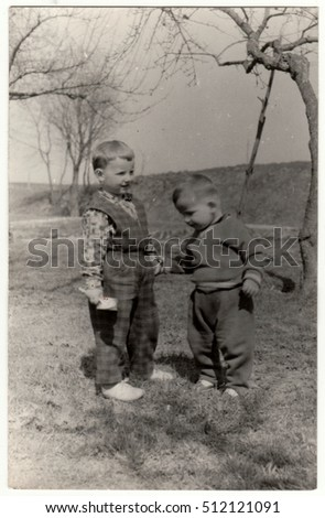THE CZECHOSLOVAK SOCIALIST REPUBLIC - CIRCA 1960s: Vintage photo shows two small boys outdoor. Retro black & white  photography.