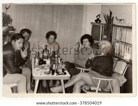 THE CZECHOSLOVAK SOCIALIST REPUBLIC - CIRCA 1970s: Vintage photo shows women and men at the home party.