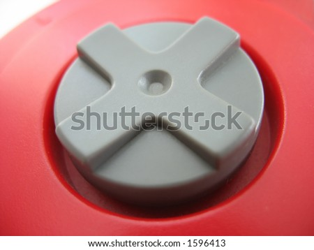 the d-pad of a red video game controller - stock photo