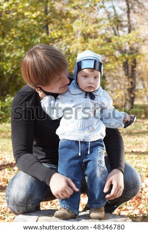 The daddy with the small son on walk - stock photo