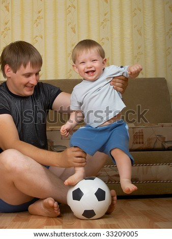 The daddy with the son play together houses - stock photo