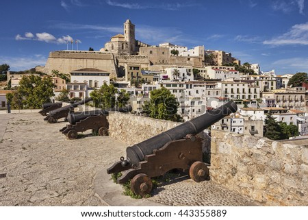 The Dalt Vila, the old part of Ibiza Town, dominated by the Cathedral, and cannon mounted on the town walls.