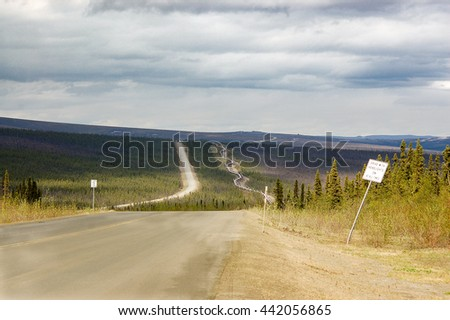 The Dalton highway, which directly parallels the Alaska pipeline, is one of the most isolated roads in the USA. - stock photo