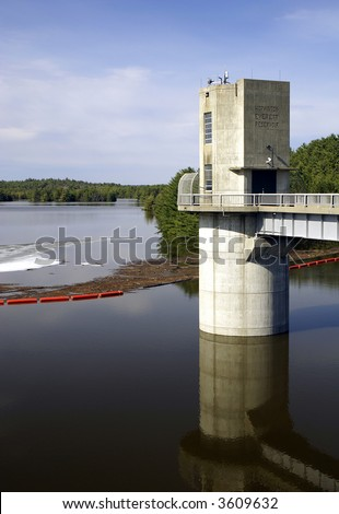 the dam tower with the flood waters in the reservoir