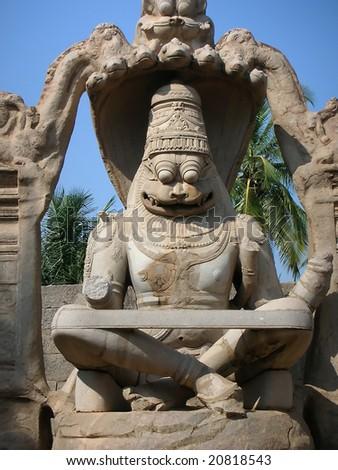 The damaged statue of hindu god Ugra Narasimha at Hampi, a world heritage site. - stock photo