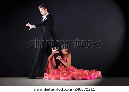 The dancers in ballroom isolated on black background - stock photo