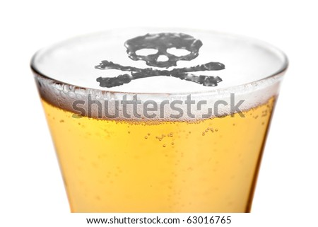 The dangers of alcoholism concept with a skull and cross bones symbol floating on top of the beer. Shallow depth of field. - stock photo