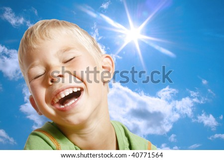 The dared boy on a background of the sky. - stock photo