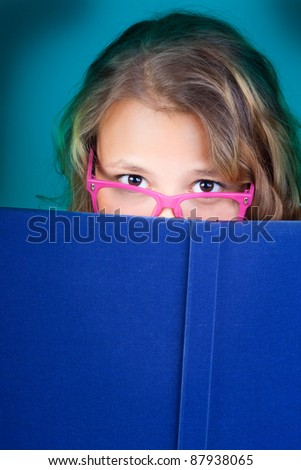 The dark blue book and the beautiful girl. - stock photo