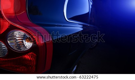 The dark blue car on a black background - stock photo