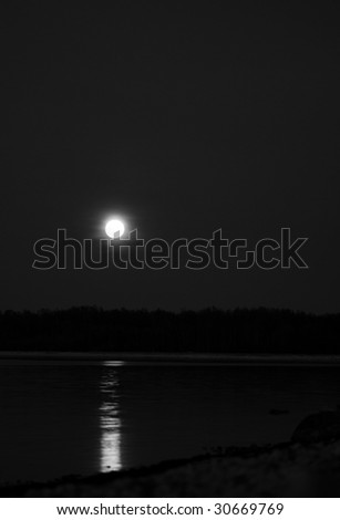 The dark moon and seaside - stock photo