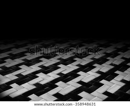 the dark room with  wooden texture of rattan patterns - stock photo