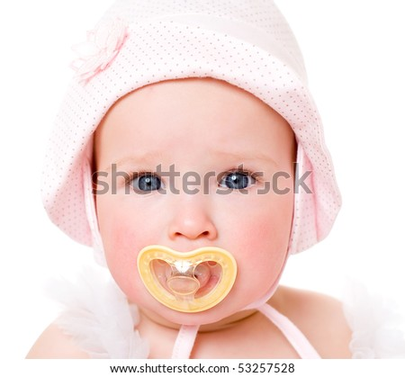 The darling baby girl with a children's dummy