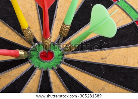 the darts hit the target on dartboard