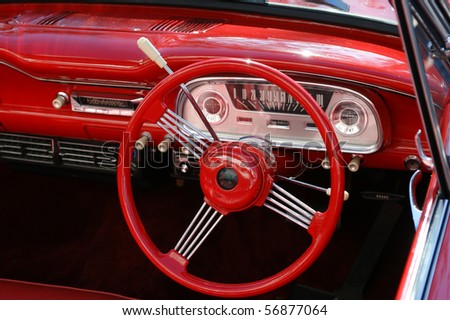 The dashboard of a restored 1960's era car. - stock photo
