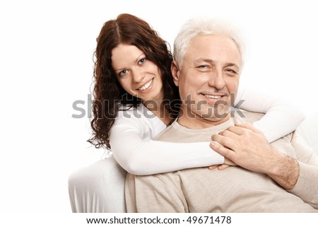 The daughter embraces the father on a white background - stock photo