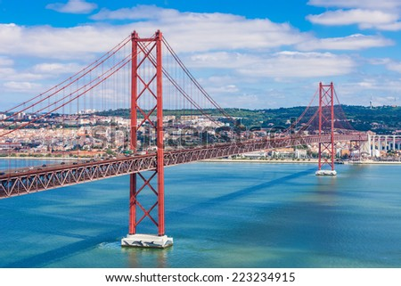 The 25 de Abril Bridge is a bridge connecting the city of Lisbon to the municipality of Almada on the left bank of the Tejo river, Lisbon - stock photo