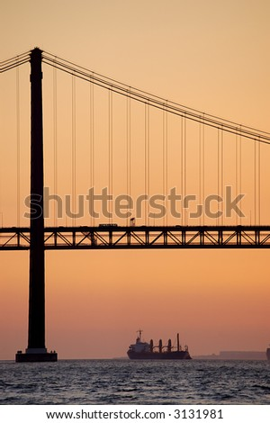 The 25 de Abril Bridge   is a suspension bridge connecting the city of Lisbon, capital of Portugal, to the municipality of Almada on the left bank of the Tagus river. - stock photo