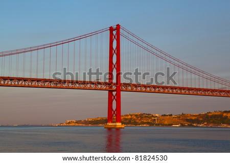 The 25 de April Bridge is a suspension bridge on river Tejo, Lisbon. - stock photo
