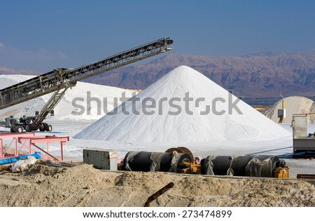 The dead sea works are producing potash products, magnesium chloride, industrial salts, de-icers, bath salts, table salt, and raw materials for the cosmetic industry. - stock photo