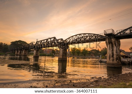 The death railway bridge is a history of world war ii, the death railway bridge over Kwai river built by Japanese soldiers at sunrise time, Kanchanaburi, Thailand - stock photo