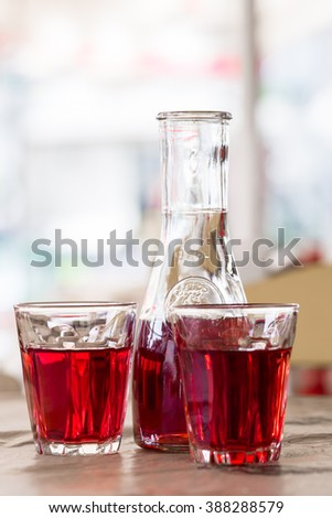 The decanter of wine and two glasses. In the tavern in Greece - stock photo