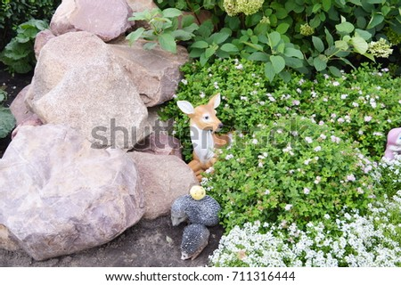 The Decoration Of The Garden: Statues Of Animals In The Grass, Deer And  Hedgehogs