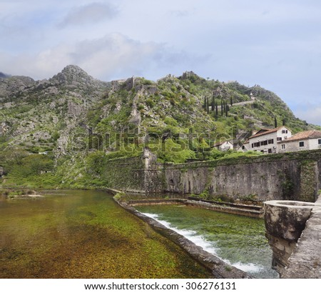 The Defensive Wall and River Outside of the Old City of Kotor, Montenegro - stock photo