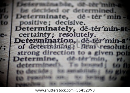 The definition of Determination is focused upon in an old dictionary. - stock photo