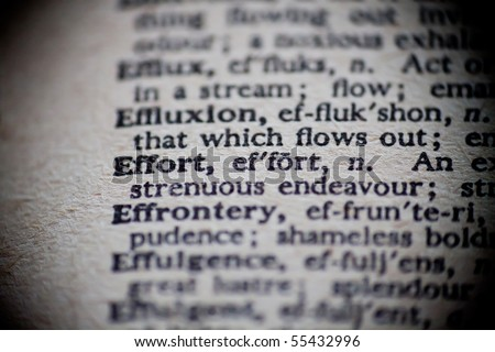 The definition of Effort is focused upon in an old dictionary. - stock photo