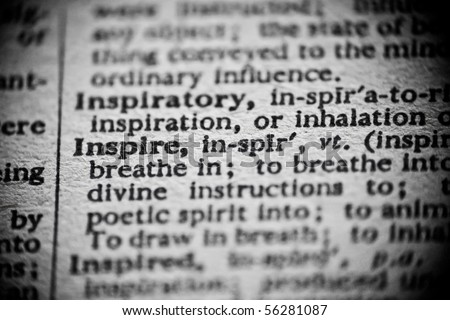 The definition of 'Inspire' is highlighted in an old dictionary. - stock photo