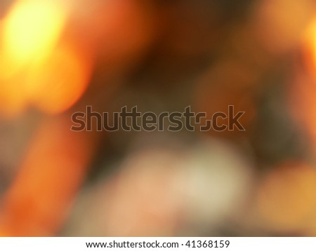 The defocused background of a flame. - stock photo