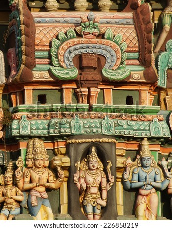 the deities of prominent Hindu gods Lord Brahma,Lord Vishnu,Lord shiva, Lord Krishna carved in a Gopuram in a temple in Kumbakonam ,India - stock photo