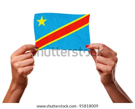 The Democratic Republic of the Congo flag in the woman hands. closeup - stock photo