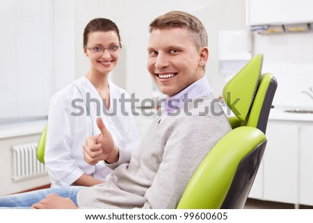 The dentist and the patient in the clinic - stock photo