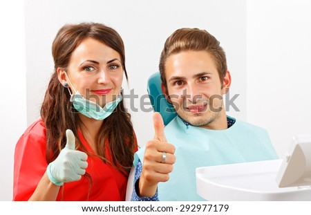 The dentist is checking the patient's mouth - stock photo