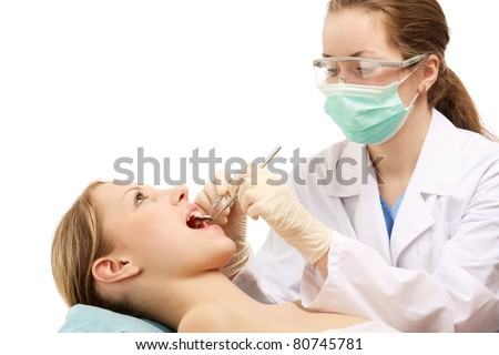 The dentist is examining teeth of a patient