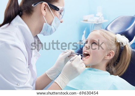 The dentist treats teeth patient - stock photo