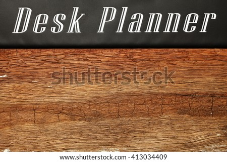 The desk planner and brown color hardwood surface represent the business planning concept related idea.