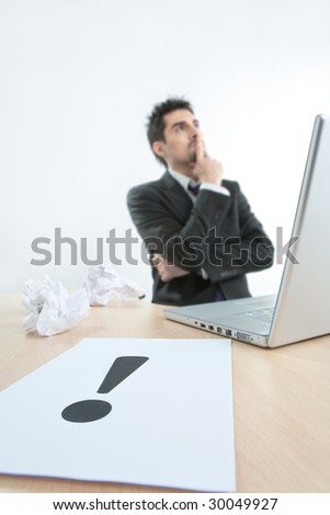 The despaired clerk has problems thinking about exclamation point - stock photo