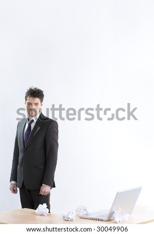 The despaired clerk has problems working with the laptop - stock photo