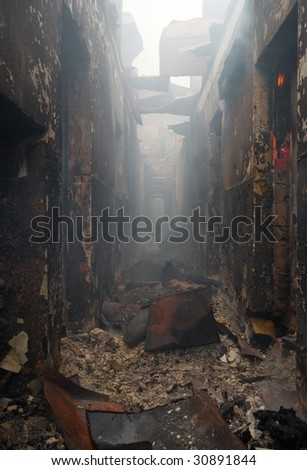 The destroyed building destroyed by the burning down fire - stock photo