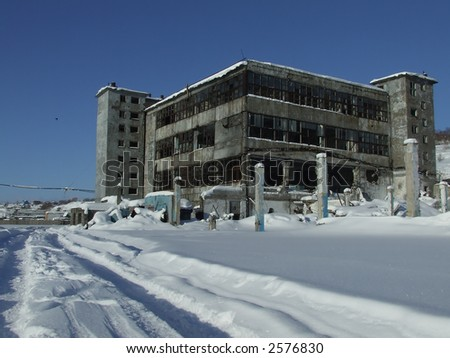 The destroyed building. The blue sky, a white snow.