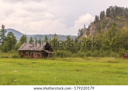 The destroyed house in a mountain valley. A landscape - stock photo