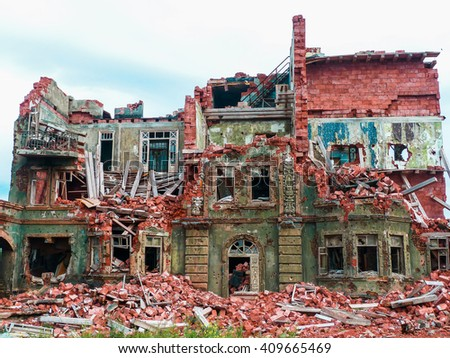 the destroyed old brick house. selective focus - stock photo