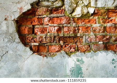 The destruction of a brick wall. background - stock photo