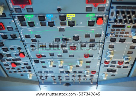 The detail of ceiling control panel in the cockpit room of the commercial airlines, selective focus.