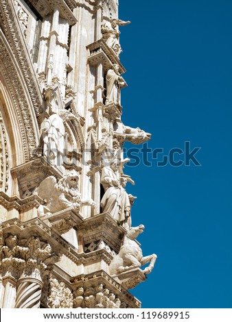 The detail of  facade of the Cathedral in Siena - stock photo