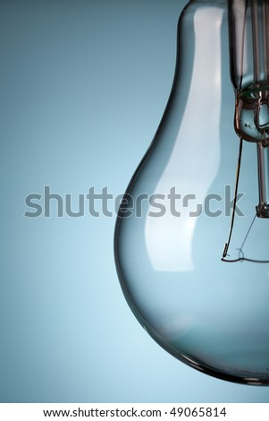 the detail of light bulb on blue background - stock photo