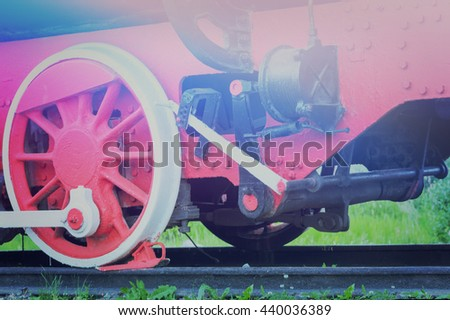 The detail of old red train wheels.Toned - stock photo